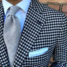 Black and white gingham guncheck blazer, grey tie, white shirt, white p square, casual Friday