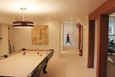 My friend's basement,  I just love the warm white and wood.