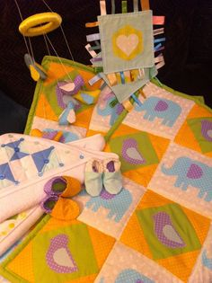 Baby shower - elephant and bird quilt, taggy, shoes, mobile and towel.