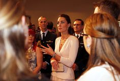 Catherine, Duchess of Cambridge talks to community officials with her husband Prince William, Duke of Cambridge, at the Playford Civic Centre in the Adelaide suburb of Elizabeth