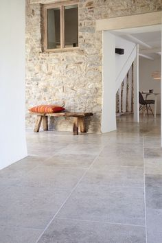 Blenheim Grey Brushed Limestone. An extremely hard European Limestone that combines slight surface texture with a blend of light-mid grey tones. Surface mottling, small shells and veining make for a forgiving floor that is equally at home in modern or traditional interiors.