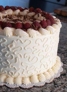 Use white chocolate ganache and skip the raspberries. White chocolate cake.