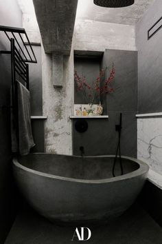 The historic and industrial loft was love at first sight for the owners, but it took five years to tailor the industrial space to fit the clients' shifting needs. In the bathroom, an Oceanstone tub helps make for a peaceful and relaxing atmosphere. The fixtures are by Zucchetti. #bathroom #bathroomideas #bathroominspo #bathtub #tub #fixtures #industrial Love At First Sight, First Love, Architectural Digest, Industrial Homes, Modern Industrial, Luxury Living, Modern Living, Red Hook, Minimalist Architecture