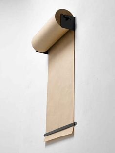 Ditch the bulky easel and hang paper on the wall.