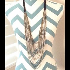 """Long multi strand layered CHAIN NECKLACE. Cute """"bohemian meets classy""""  long multi strand layered chain necklace. Braided black ribbon holds multi length/style chains together. Color: Brass, silver, rhinestone chains. Adjustable length spring clasp. Bought at Coachella  Jewelry Necklaces"""