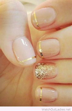 Nude and gold Christmas nail design