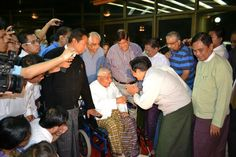 SN Goenkaji arrive at Burma airport and being greeted by students in December 2012