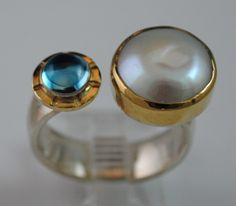 size 8.5. Sterling silver and 14kt gold.