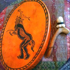 Shaman:  This Shamanic drum is a commissioned piece from a Saami tribe in Lapland; the picture is from a cave painting in France.