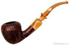 The stem on this pipe is lovely.  Randy Wiley Galleon Partially Rusticated Bent Acorn Pipes at Smoking Pipes .com