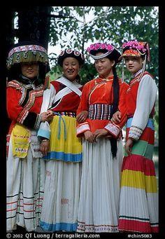 Women wearing Naxi dress. Lijiang, Yunnan, China