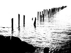 Old Bridport Jetty, burnt down twice around 1930 with a bit of editing done.