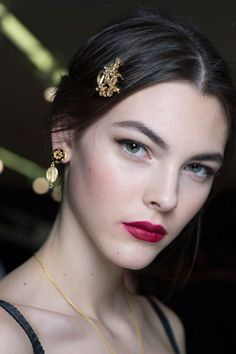 Fall, Winter 2015, 2016, Trend #2: Floral Decadence Lips were stained in shades of rose while the cheeks were flushed in petal pinks. INSPIRATION • Rose, very poetic, romantic, gorgeous BEAUTY • Groomed brows • Perfect nude skin • Taupe eyeshadow • Soft black winged eyeliner • Black mascara • Matte deep rose red and matte nude lipstick