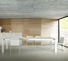 The Stunning Bianco Dining table by C Dondoli & M Pocci in 2010 extends to double it size with the aid of three additional extension leaves. Its vital statistics are x x cm. Available in White and Argile glass and Aluminium or White Laminate version. Corner Dining Table Set, Dining Table With Leaf, Modern Dining Room Tables, Extension Dining Table, Dining Table Chairs, Modern Table, Table Furniture, Contemporary Bar Stools, Modern Bar Stools