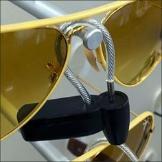 Simple Piano Wire is the method of attachment for this ordstrom Sunglass Nose Bridge Anti-Theft Device. Thin and Flexible it is easily threaded through. Retail Fixtures, Store Fixtures, Ultra Violet, Eyewear, Bridge, Fashion Accessories, Nordstrom, Sunglasses, Eyeglasses