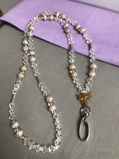 Clear beaded lanyard with gold tone accents Beaded Shoes, Beaded Jewelry, Handmade Jewelry, Lanyard Necklace, Diy Necklace, Necklaces, Gold Beads, Crystal Beads, Crystal Bead Necklace