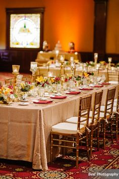 Gold Chiavari Chairs with Ivory cushions & Gold Beaded Glass Charger Plates.