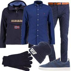Un po' sportivo e un po' elegante nella proposta per uomo che vede un paio di pantaloni in fantasia delicata abbinati ad una camicia di taglio classico, da indossare con un giubbotto sportivo, scarpe sneakers, un paio di guanti e un cappellino in lana.
