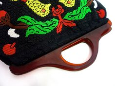 http://www.huzzarhuzzar.com/collections/all-products/products/lovely-70s-large-beaded-handbag-featuring-bird-motif