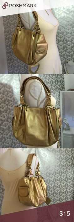 Juicy Couture gold hand bag Normal wear needs to be washed still in good condition mirror has a small crack a couple of normal wear spots on purse 10 inches in width 9 inches in length has two side pockets and two pockets inside Juicy Couture Bags