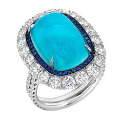A rare and ultra exclusive 12.34ct Brazilian Paraiba Tourmaline, cushion cabochon, showcased in a 2.77ct diamond and 0.24ct Sapphire ring. Master-crafted in platinum. 21st century