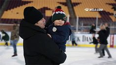 Zach Parise fixes his son's hat at the Minnesota Wild's family skate