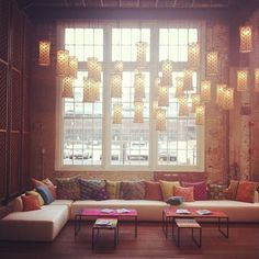 Hanging lanterns and colorful pillows.