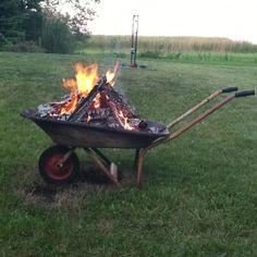 Jaimi wants a mobile fire pit.....Old wheelbarrow fire pit