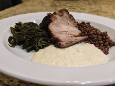 A truly #Southern #Recipe. Roasted Pork Shoulder, Braised Garden Greens, Sea Island Red Peas and Sweet Onion Puree. Follow the link for the details. Red Peas, Slow Cooked Pork, Pork Shoulder Roast, Pork Roast, Great Recipes, Onion, Southern, Sea, Island