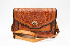 Vintage Tooled Leather Purse SALE. $45,00, via Etsy.