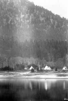 Nez Perce camp seen across a river, ca. 1908 :: American Indians of the Pacific Northwest -- Image Portion