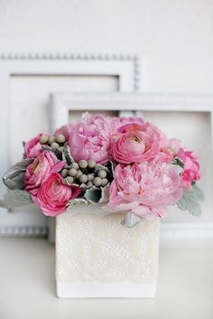 peonies, ranunculus, silver brunia, dusty miller- love the addition of the grey with the peonies