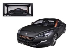 2012 Peugeot RCZ R Black / Gold 1/18 Diecast Car Model by Norev - Brand new 1:18 scale diecast model of 2012 Peugeot RCZ R Black / Gold die cast car model by Norev. Brand new box. Rubber tires. Has opening hood and doors. Made of diecast with some plastic parts. Detailed interior, exterior, engine compartment. Dimensions approximately L-10, W-4, H-3 inches.-Weight: 4. Height: 8. Width: 15. Box Weight: 4. Box Width: 15. Box Height: 8. Box Depth: 7