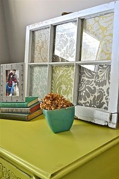 Neat idea using an old window and fabric or scrapbook paper. I can see this used for holiday/seasonal decor or even to display child's artwork. Cute.