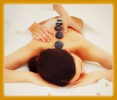 Beautiful woman receiving hotstone massage at spa CC: Zenspa1
