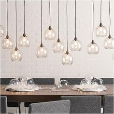 """Firefly Pendant Lamp $199 - Industrial modern chandelier suspends five glass globes from black iron canopy. Pendants stagger in length on black cords 15"""" to 29"""". Great look with filament bulbs.   Black iron canopy with five black iron adjustable arms Clear glass shades Five 25W type G bulbs not included Accommodates compact fluorescent lightbulbs (not included) UL listed Professional hardwire installation recommended  Product: Firefly Pendant Lamp Retailer: CB2"""