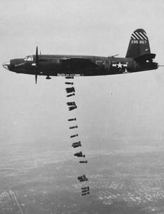"B-26B Marauder ""Shootin' In"" of the 556th Bomb Squadron releasing its bomb load, 1944-45."