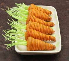 3-D Stacked Carrot Cookie ~ Here's a tasty treat for your Easter table. Any bunny would have fun creating these simple, stacked carrot cookies, complete with edible green tops! Link to recipe and step-by-step tutorial on page