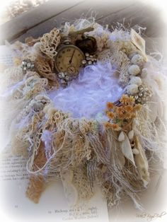 A beautiful handmade nest containing personal treasures from the lovely, talented Vicki from 2 Bags Full