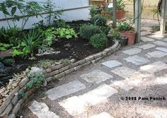 This is what I want for our new yard. Pea gravel and limestone next to a raised bed with a stone retaining wall. Beautiful, doable.