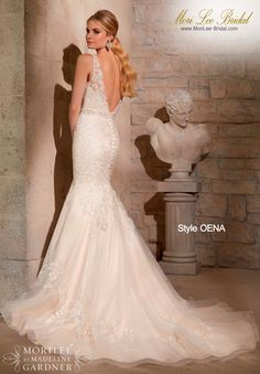 Style OENA  EMBROIDERED APPLIQUES ON NET WITH CRYSTAL BEADING Available in White, Ivory, Gold  Precio: $4.468.750 Pesos Colombianos  Precio : $ 2.031.00 Dólares Americanos
