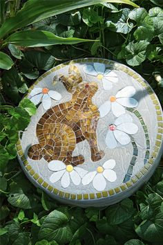 Mosaic stepping stones are a great DIY way to update your garden. Plus, this easy mosaic project is a great way to get started making mosaic craft.