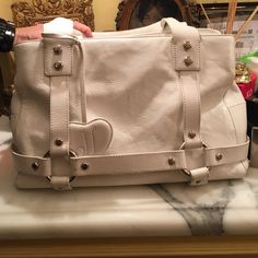 JUICY COUTURE TOTE BAG Worn white juicy tote bag. Has a pen stain on top. Huge bag very spacious. Juicy Couture Bags Totes