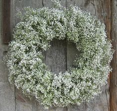 Love this Baby breath wreath - would look lovely outside the church gates