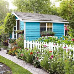 Aqua blue garden cottage shed with flowers Garden ideas and inspiration