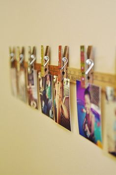 Love this photo display idea! (TEEK: Nice idea would be to put up pix of kids at the different heights on the yard stick. Very Cute!)