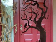 Welcome Halloween visitors with a spooky tree silhouette on your door! Draw twisty branches and roots, and add a couple of owls to give the tree a haunted feel. You can use adhesive vinyl for this, or if your door is sheltered from the weather you can cut your shapes from poster board and mount with double sided picture hanging strips that won't hurt the paint.