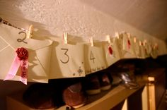 For Advent last year I used mini envelopes, mini pegs and christmas ribbon to make a special advent calendar for my boyfriend. Simply make little vouchers, notes, and put them in as well as small amounts of money or little gifts. Worth seeing the smile every morning!
