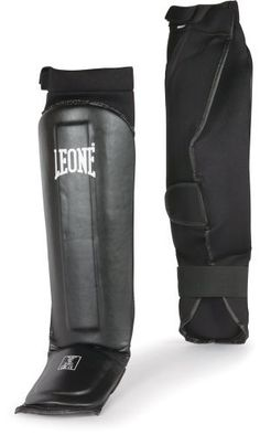 Leone Neoprene Grappling Guards, L by Title Boxing. $24.99. Incredible sleek and savvy grappling shin and instep guards are crafted for perfect adherence and stability in every round. Protective and secure Neoprene cover with a thinner shock absorbing shin, ankle and instep foams. Stretch cotton rear sock provides a firm fit for all grappling and MMA demands. Leone offers the ideal grappling guards for professional and amateur combatants.