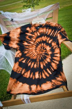 bleach tie-dye wonder what it would look like if you dipped it in orange dye afterward?